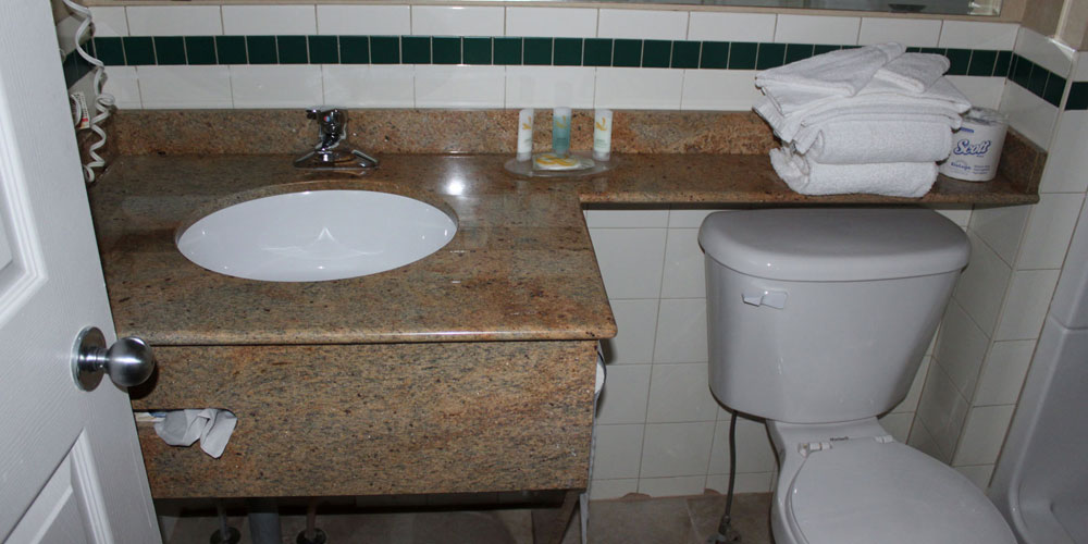inside view of a bathroom with complimentary use of white towels and soap