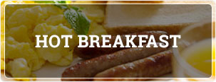 delicious hot breakfast with sausage, scrambled eggs, toast and orange juice