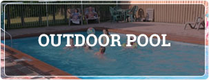 seasonal outdoor heated pool with people playing with a beach ball